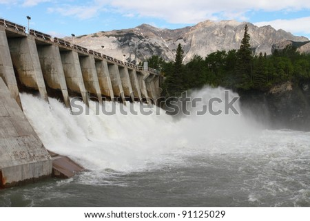 Spillway of a hydro electric dam in the Rocky Mountains of Canada - stock photo