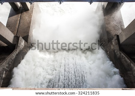 Spillway on hydroelectric power station dam - stock photo