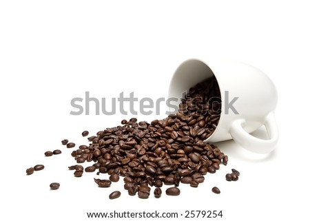 spilt coffee beans - spill the beans - closeup of whole beans with limited depth of field, isolated on white - stock photo