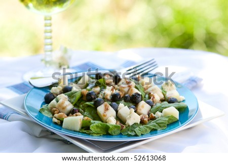 Spinach And Gorgonzola Cheese Salad With Blueberries and Pears - stock photo
