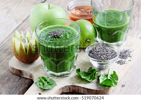 Spinach and green fruits smoothie with ingredients.Super foods and clean eating concept. Selective focus