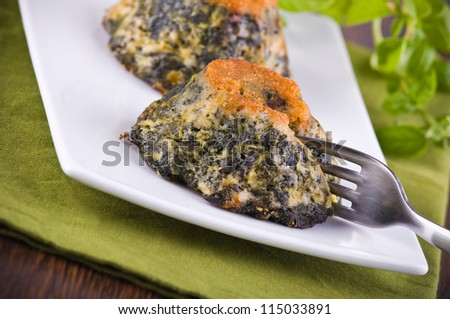 Spinach cakes on wooden cutting board.