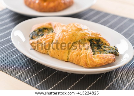 spinach croissant on the table