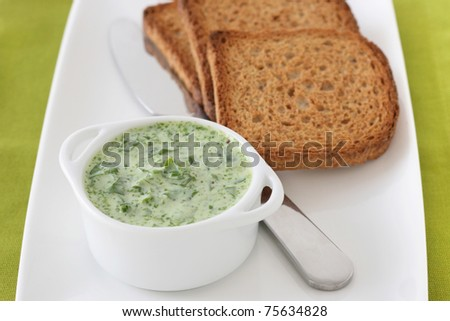 spinach dip with toasts - stock photo