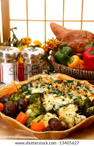 Spinach Feta Strata and Herb Baked Vegetables in kitchen or restaurant. - stock photo