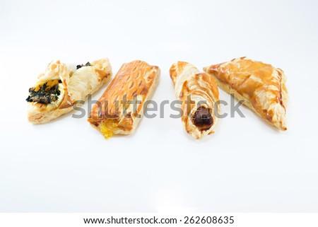 Spinach Pie, Sausage Pie, Sauce Chicken Pie, Pineapple Pie isolated on white background - stock photo
