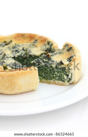 spinach quiche pie isolated on white background - stock photo
