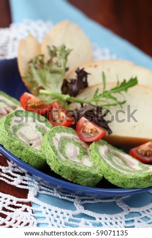 Spinach rolls with garlic cheese and ham. Shallow dof - stock photo