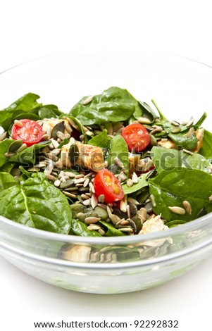 Spinach salad over white background - stock photo