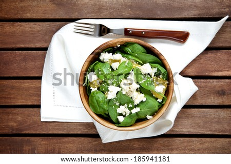 Spinach salad with oranges and sesame seeds, top view - stock photo