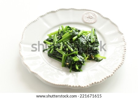 spinach sauteed on dish with copy space - stock photo