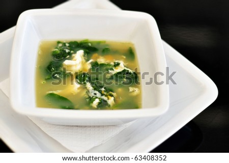 spinach soup on black background, isolated. - stock photo