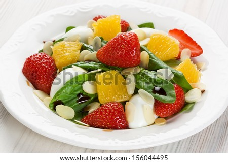 Spinach, strawberry, orange salad   - stock photo