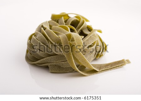 spinach tagliatelle from italy on white background