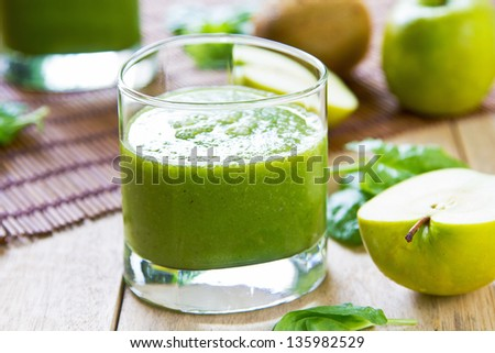 Spinach with Apple and Kiwi smoothie - stock photo