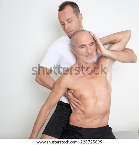 Spinal manipulation - stock photo