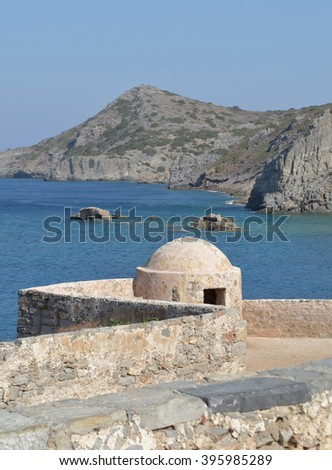 Spinalonga Fort Architecture with View Across to Island of Crete - stock photo