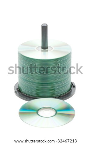 Spindle of cd disks isolated on white - stock photo