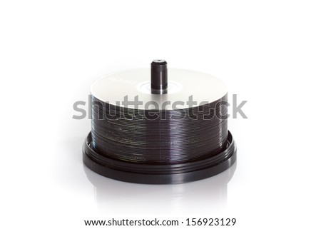 spindle of dvds isolated on a white background - stock photo