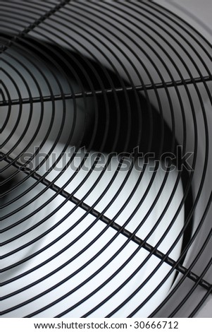 Spinning AC fan - stock photo