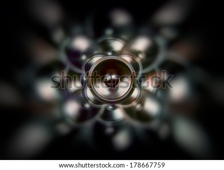 Spinning audio speaker on a dark spinning background - stock photo