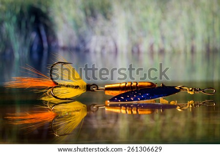 spinning bait with two-tone front sight on a triple hook - stock photo