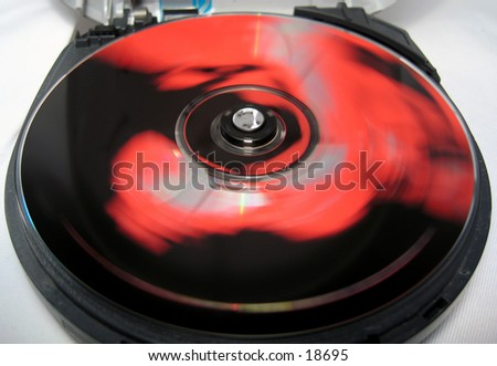spinning compact disc in a cd player