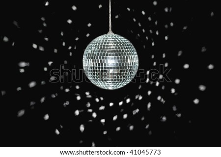 spinning discoball, over black background, light reflections - stock photo