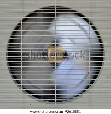 spinning fan of air-compressor - stock photo