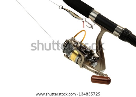 Spinning rod and fishing coil with thread close up on white background - stock photo