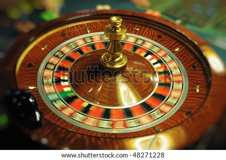 Spinning roulette in casino - stock photo