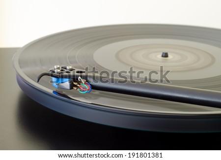 Spinning vinyl on a turntable. - stock photo
