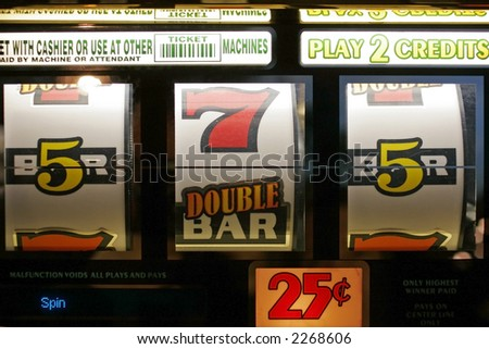 Spinning wheels of a slot machine in Las Vegas - stock photo
