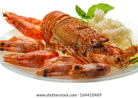 Spiny lobster, shrimps and rice - stock photo