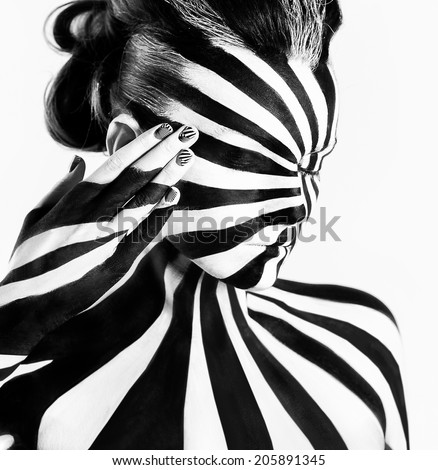 Spiral bodyart on the body of a young girl. Look like zebra pattern skin - stock photo