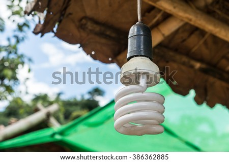 Spiral fluorescent lightbulb in the cabin - stock photo