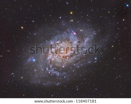 spiral galaxy approximately 3 million light years from Earth in the constellation Triangulum - stock photo