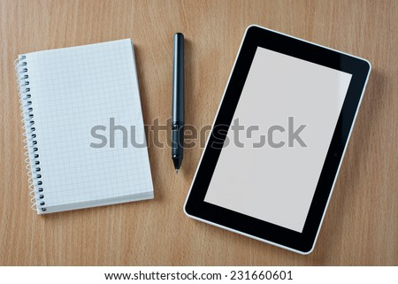 Spiral Graphing Notebook, Black Ballpoint Pen and Tablet Device on Top of Wooden Desk with Copy Space for Texts.
