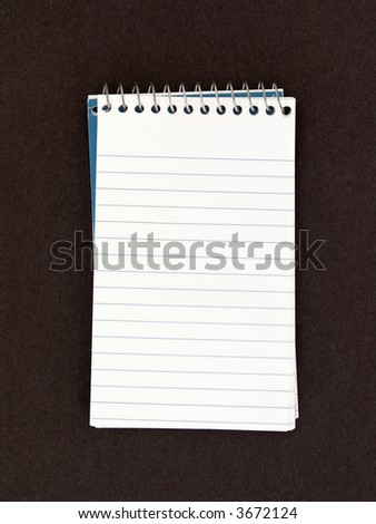 Spiral Note Pad on Textured Background
