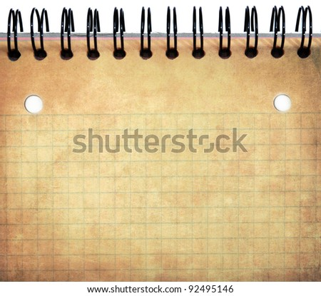 Spiral notebook in grunge style, old dirty paper texture - stock photo