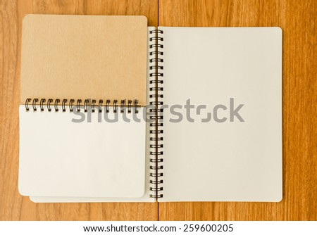 Spiral notebook on wood background