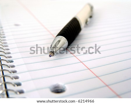 spiral notebook with pen - stock photo
