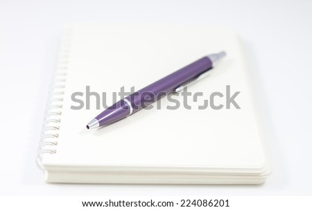 Spiral notebook with pen isolated on white background, stock photo