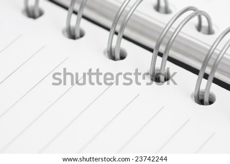 spiral notebook with striped paper