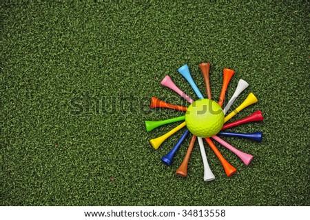spiral of golf tees around golf ball - stock photo