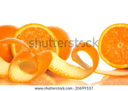 Spiral orange peel and juicy oranges on white background. - stock photo