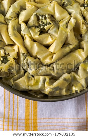 Spiral pastry with cheese and dock - stock photo