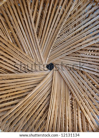 Spiral pattern made from woven cane - stock photo