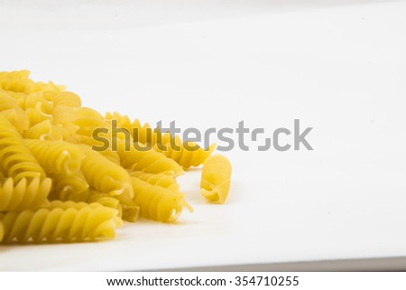 spiral raw macaroni pasta background with space for text