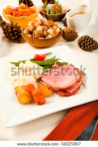 Spiral Sliced Ham on plate with Vegetables - stock photo